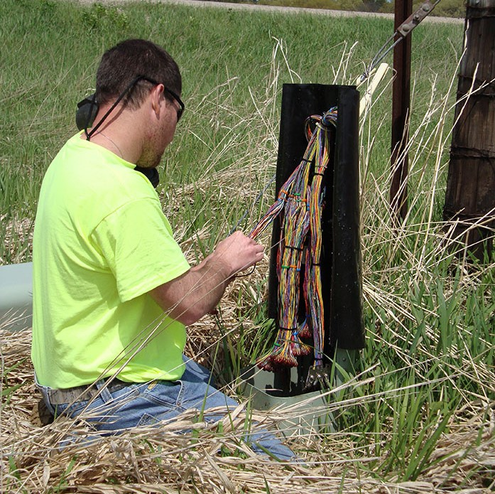 central cable worker organizes cable wires