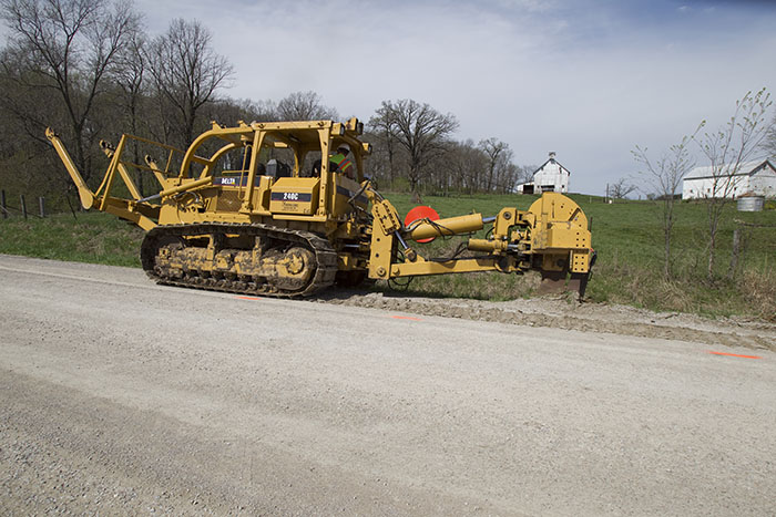 cable worker using an excavator at a work site