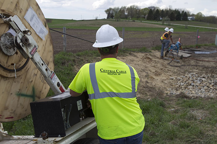 central cable workers looking at a work site