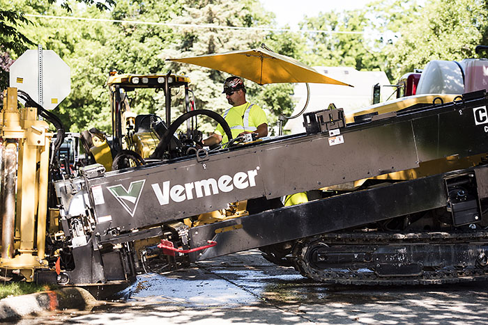 Central Cable worker driving a Vermeer machine